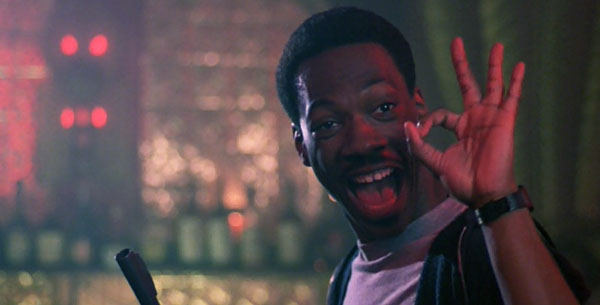 beverly-hills-cop-axel-foley-ok-sign-strip-club